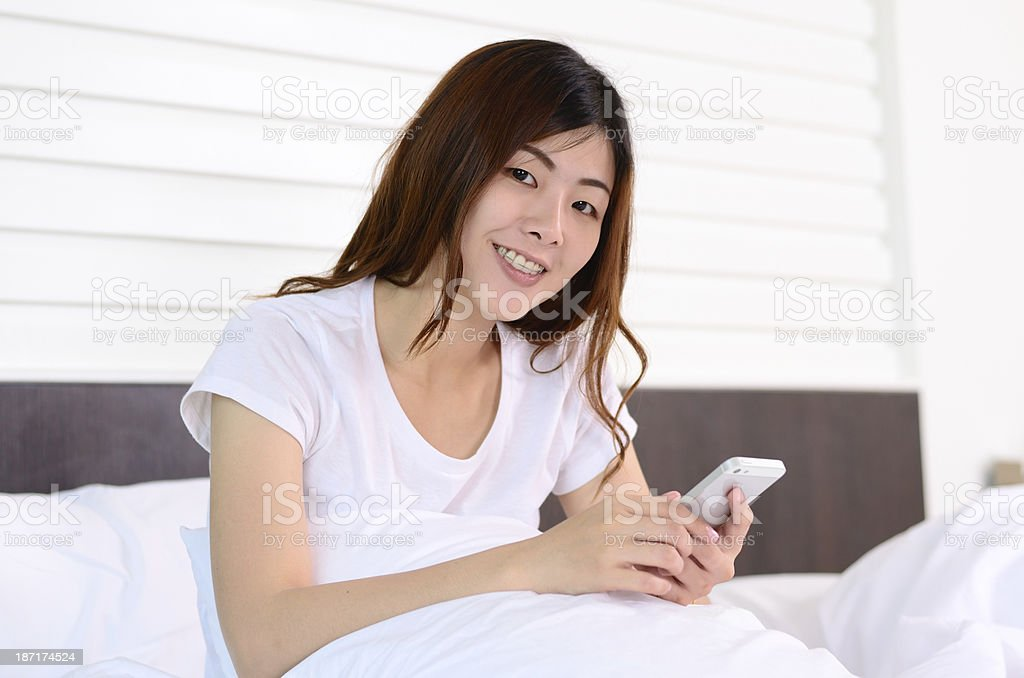 Asian teenage talking and chat with tablet royalty-free stock photo