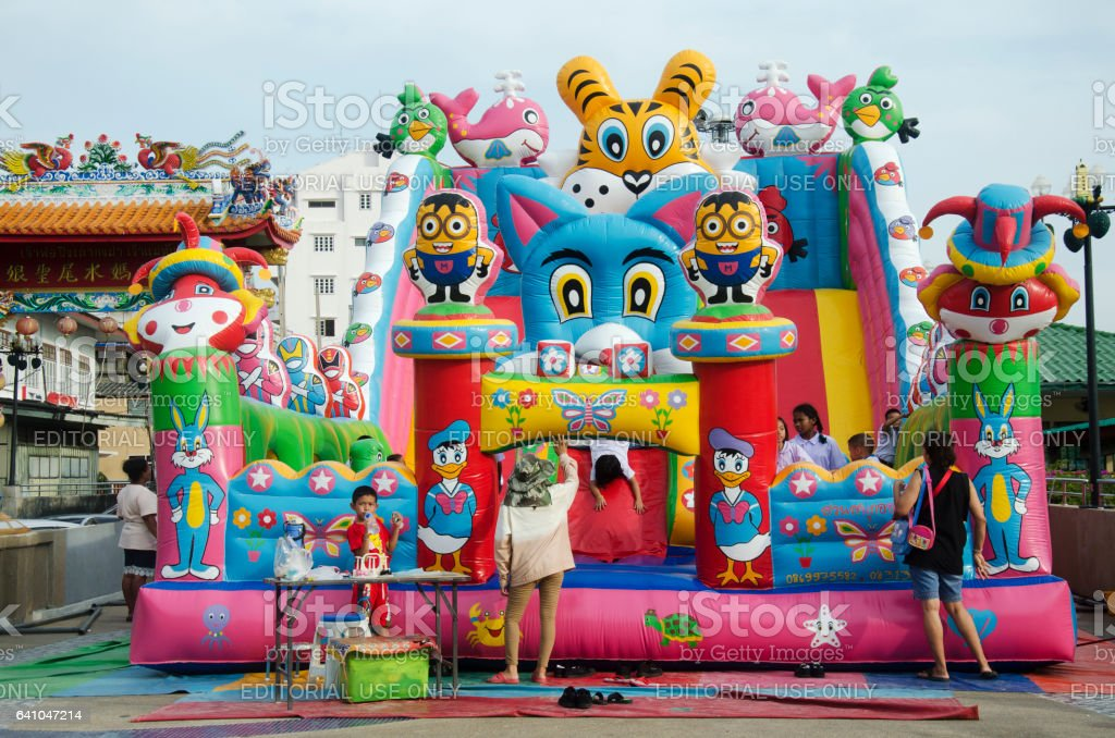 Asian thai children relax playing on inflatable playground stock photo