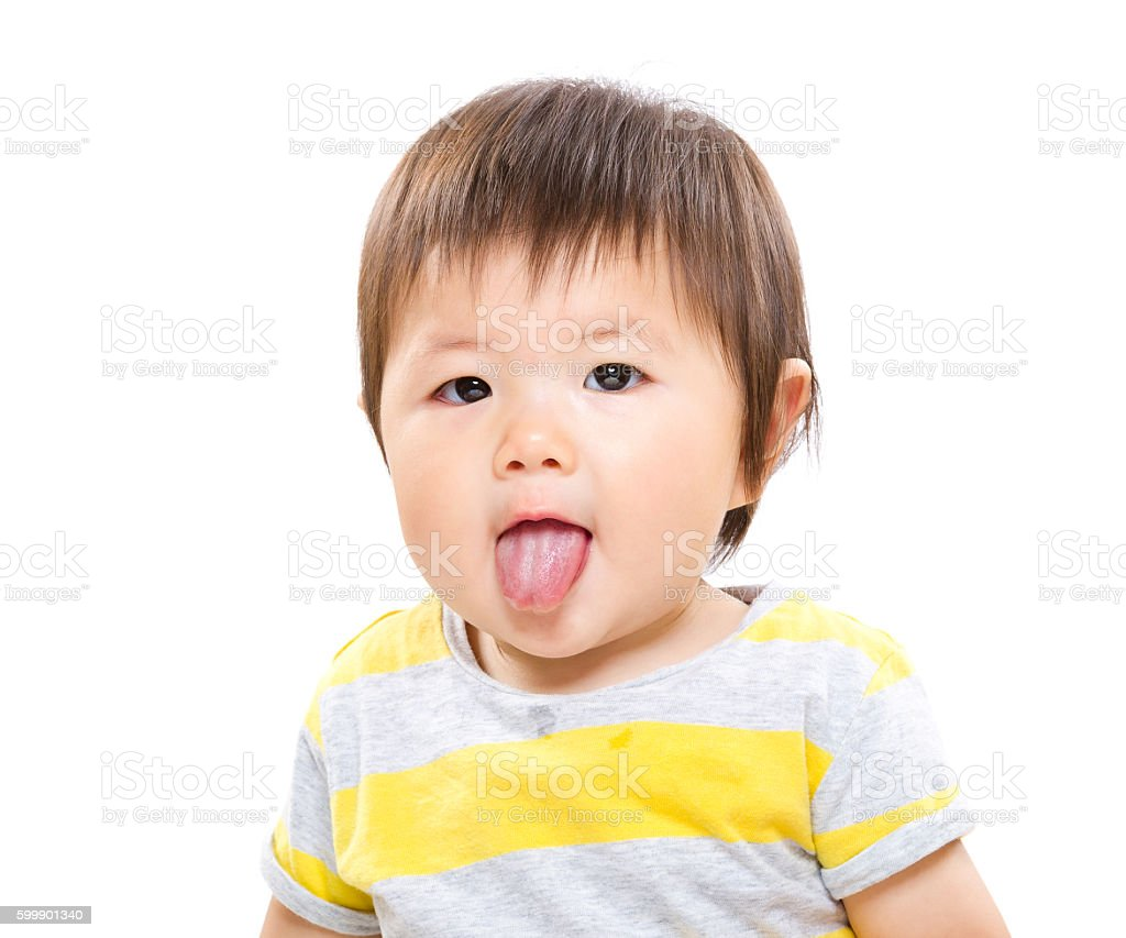 Asian toddler sticking tongue out stock photo