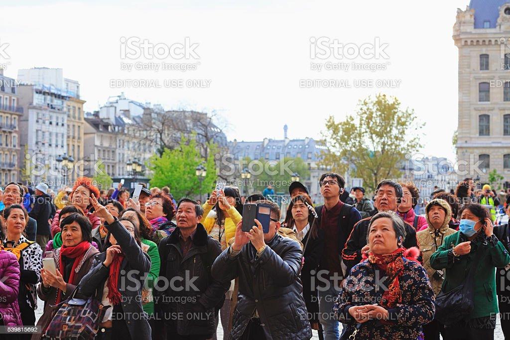 Asian tourist convoy in The Notre Dame, Paris stock photo