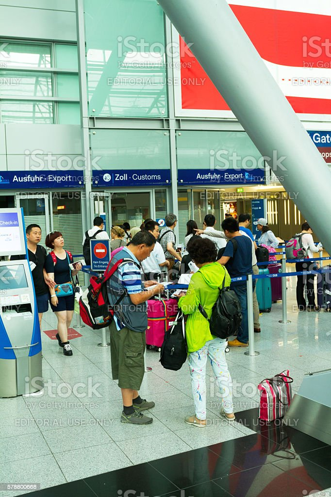 Asian tourists and passengers of custom before departure stock photo