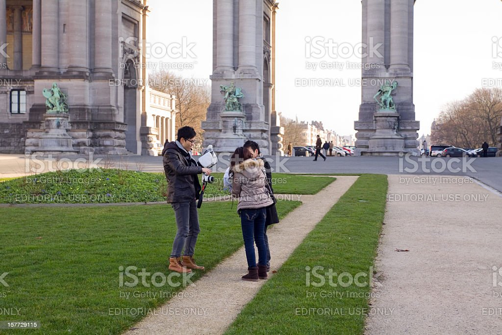 Asian Tourists at Arc de Triomphe in Brussels stock photo