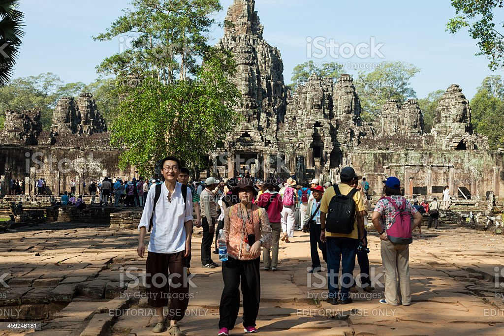 Asian Tourists in Bayon temple, Angkor, Cambodia royalty-free stock photo