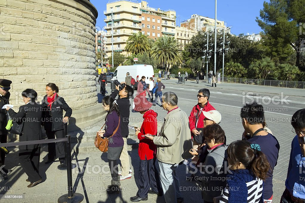 Asian tourists in queue at Sagrada Familia royalty-free stock photo