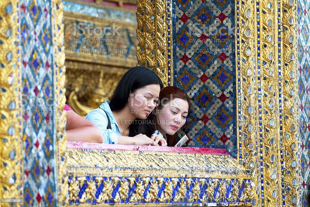 Asian tourists in Wat Phra Kaeo royalty-free stock photo