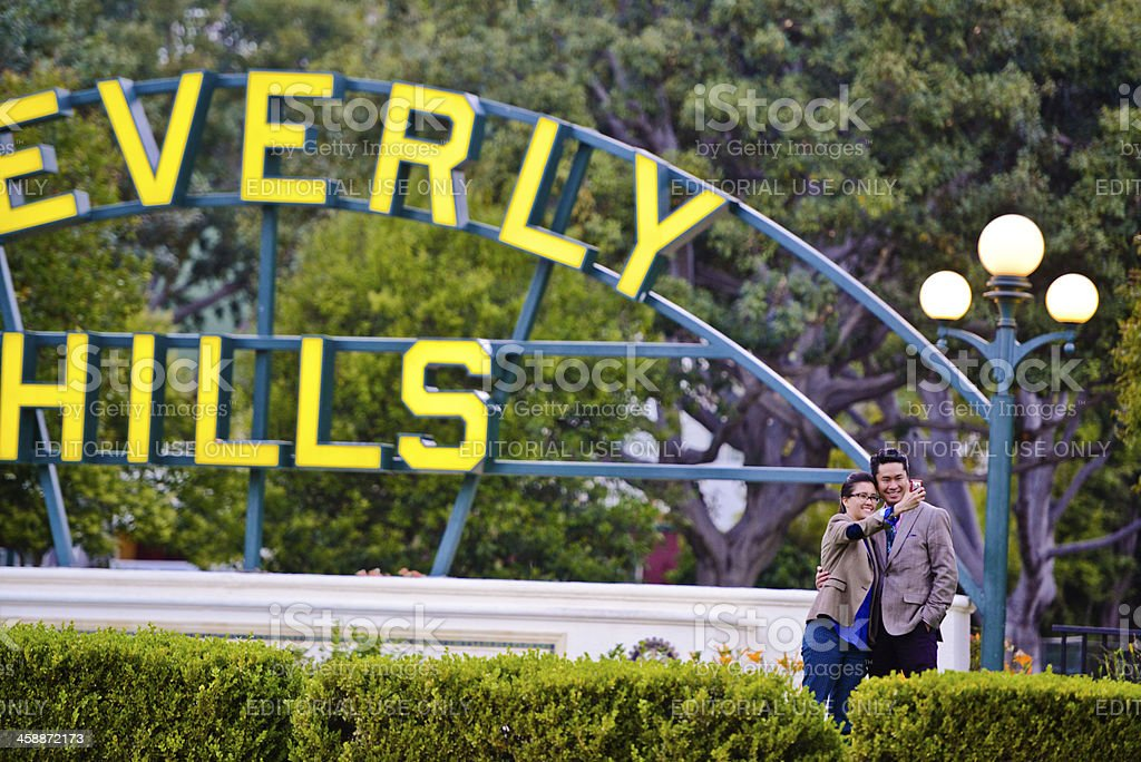 Asian Tourists making self portrait with Beverly Hills Sign royalty-free stock photo