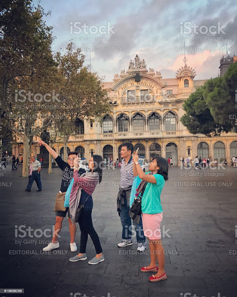 Asian tourists photographing in Port Vell, Barcelona stock photo