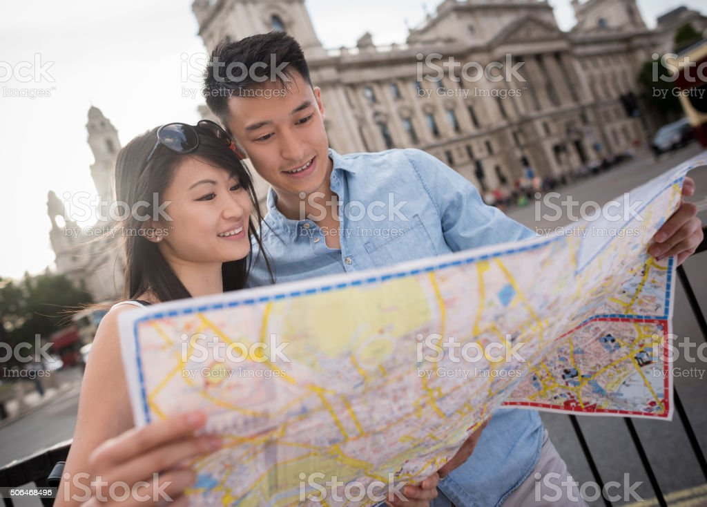 Asian tourists traveling and holding a map stock photo