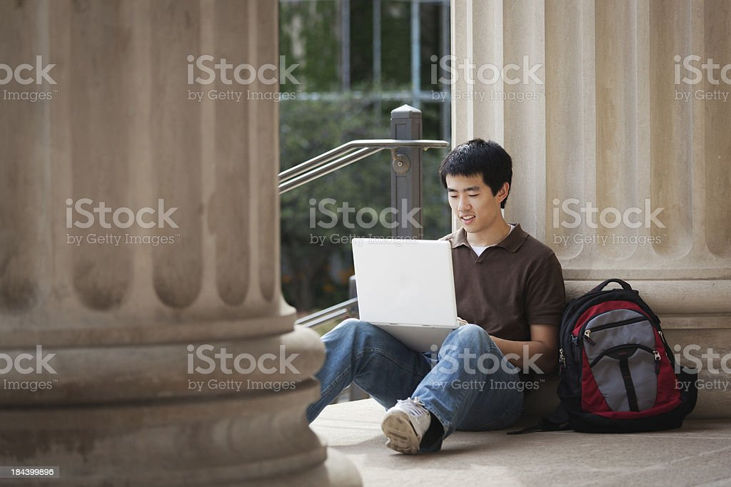 Asian University Student with Laptop Computer on College Campus stock photo