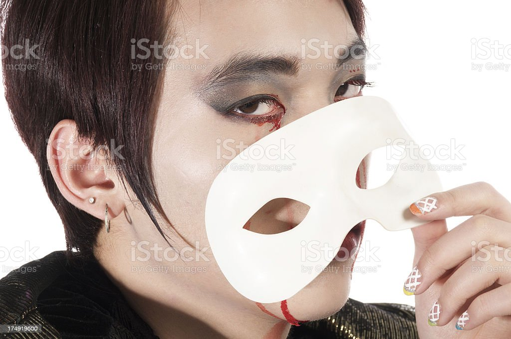 Asian vampire peeking over mask royalty-free stock photo