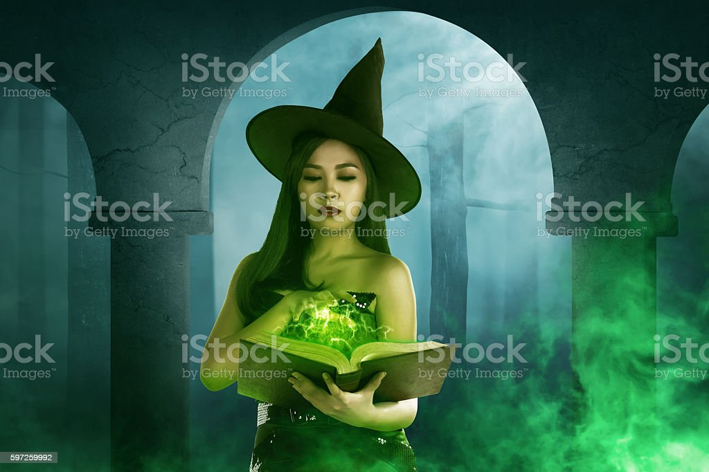 Asian witch woman holding the  book of magic stock photo