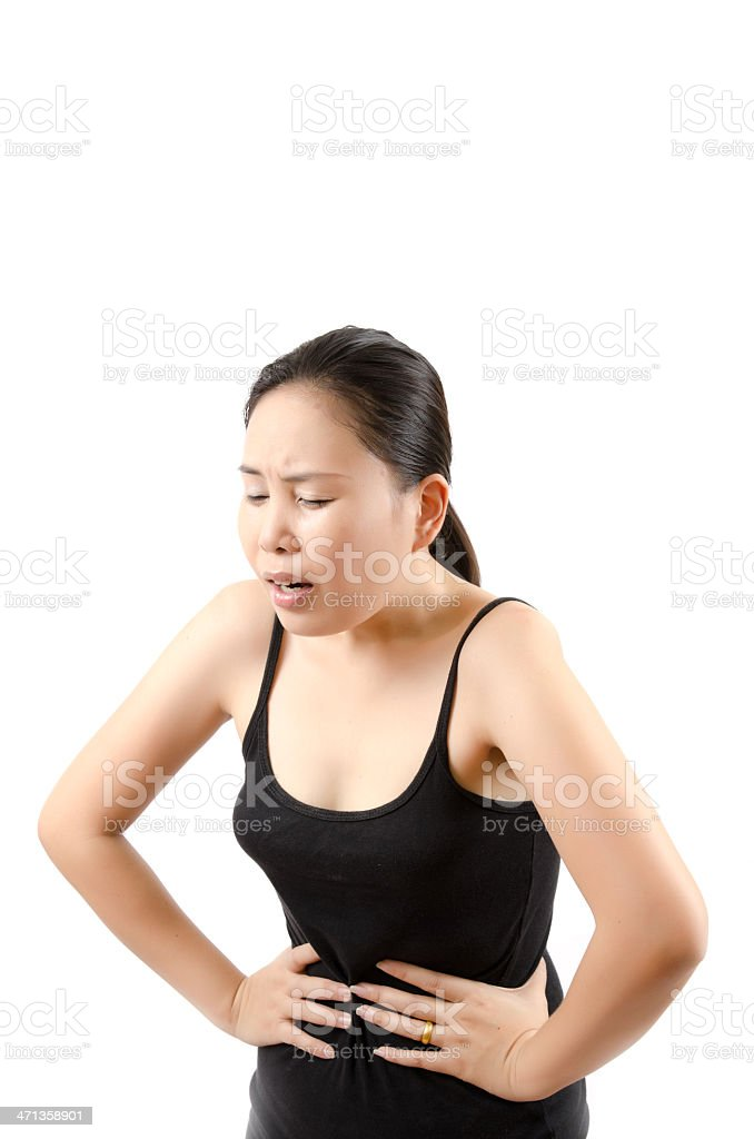 Asian woman abdominal pain. stock photo