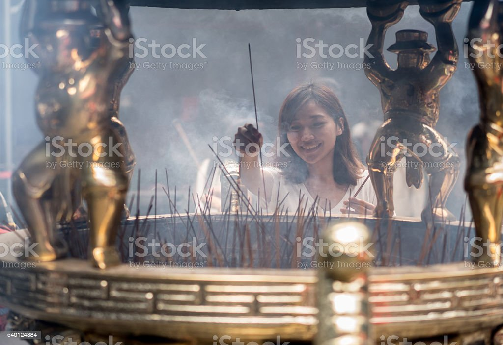Asian woman at a Buddhist temple stock photo