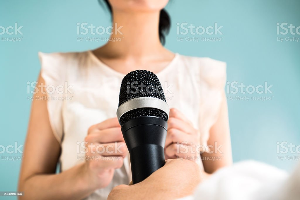 Asian woman at a press conference stock photo