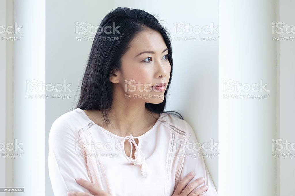 Asian Woman At Window stock photo