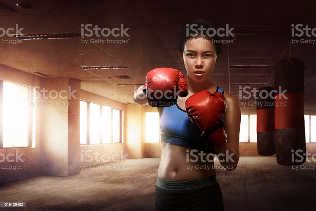 Asian woman boxer training boxing stock photo