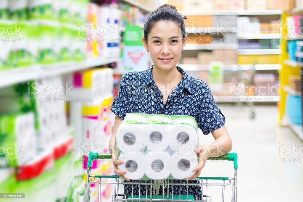 Asian woman buying toilet paper stock photo