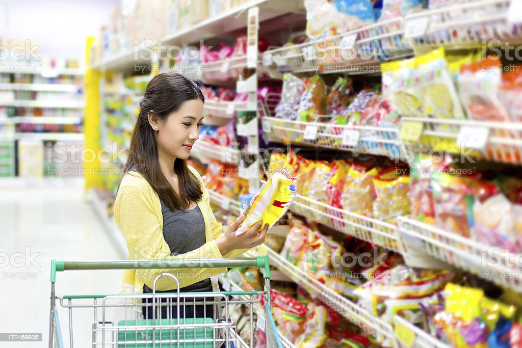 Asian woman checking food labelling royalty-free stock photo