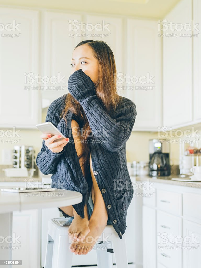 asian woman checking phone messages stock photo