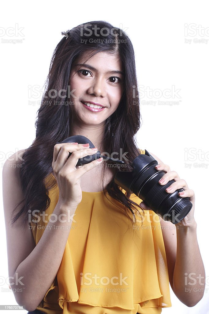 Asian woman cleaning the len. royalty-free stock photo