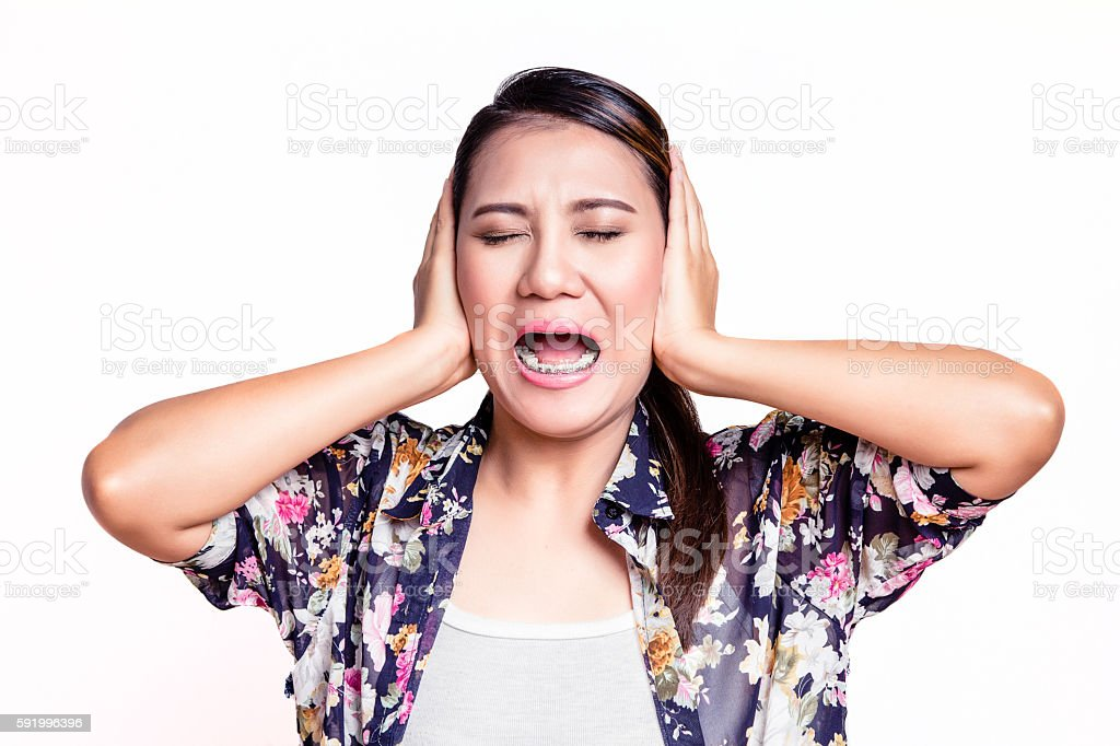 Asian woman covers his ears with her hands stock photo