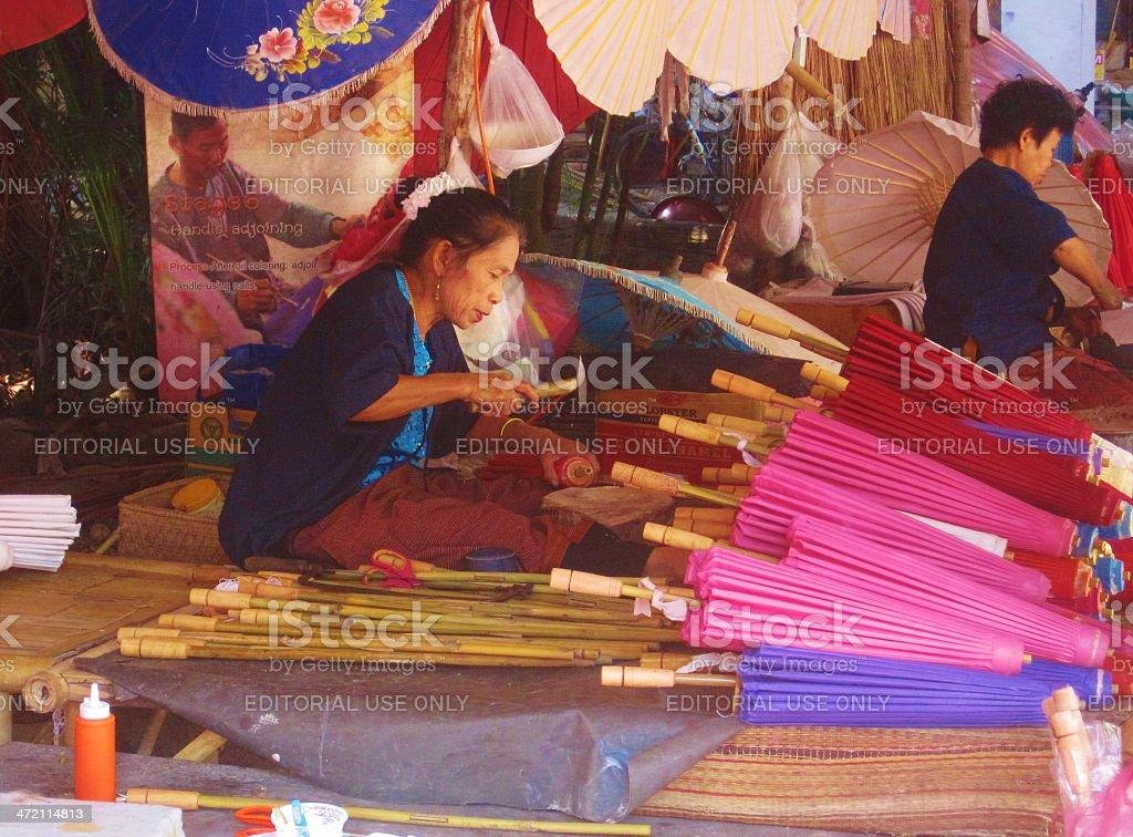 Asian Woman Crafts Sun Umbrellas stock photo