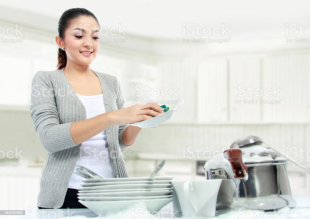 asian woman doing house work stock photo