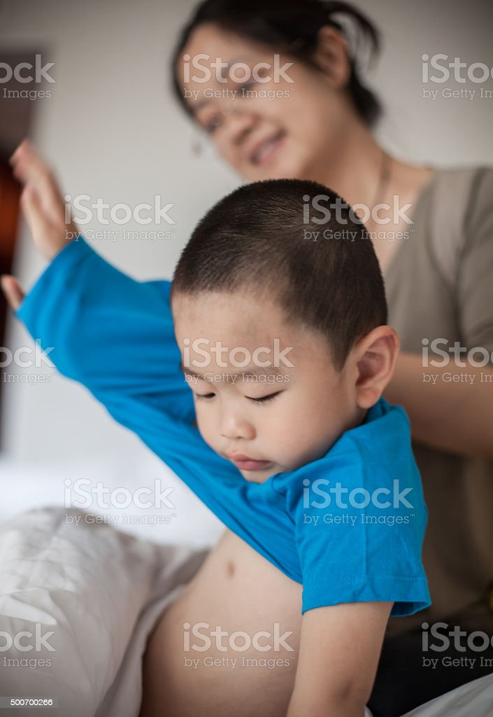 Asian Woman Dress Her Son stock photo