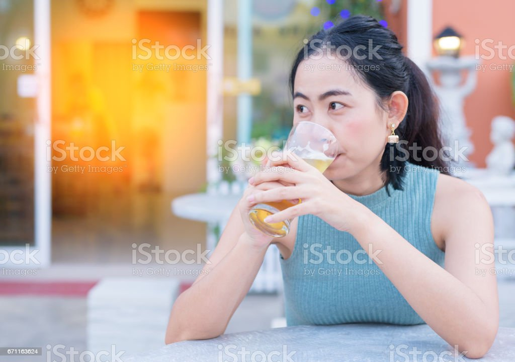 Asian woman drinking beer in summer lifestyle stock photo
