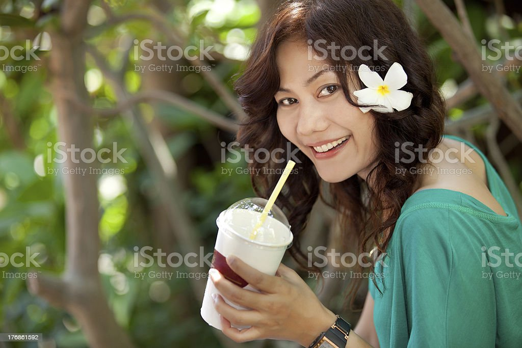 asian woman drinking royalty-free stock photo