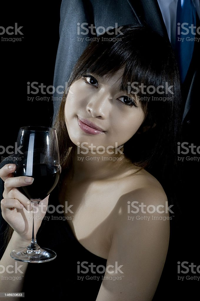 Asian woman drinking wine royalty-free stock photo