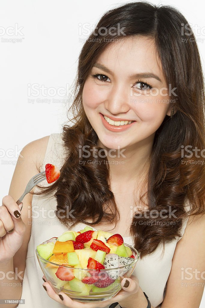 Asian woman eating fruit salad royalty-free stock photo