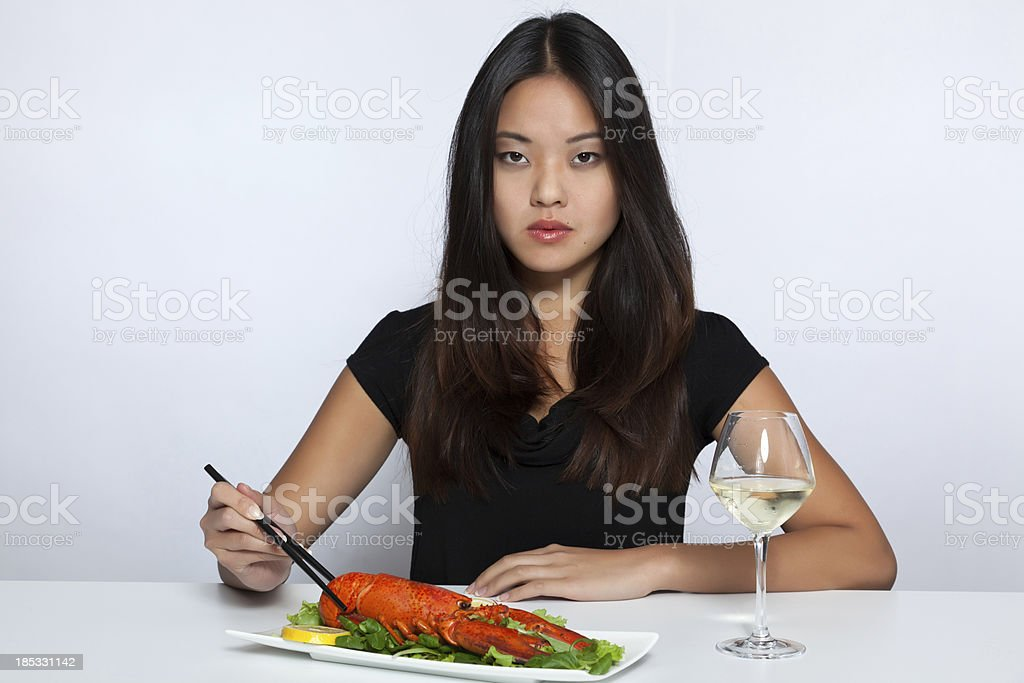 Asian woman eating lobster stock photo