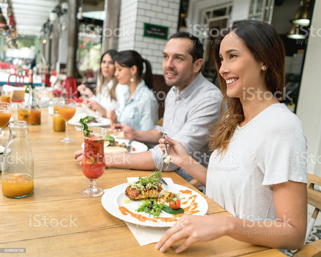 Asian woman eating with friends stock photo