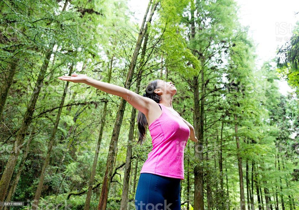 Asian woman enjoying fresh air stock photo