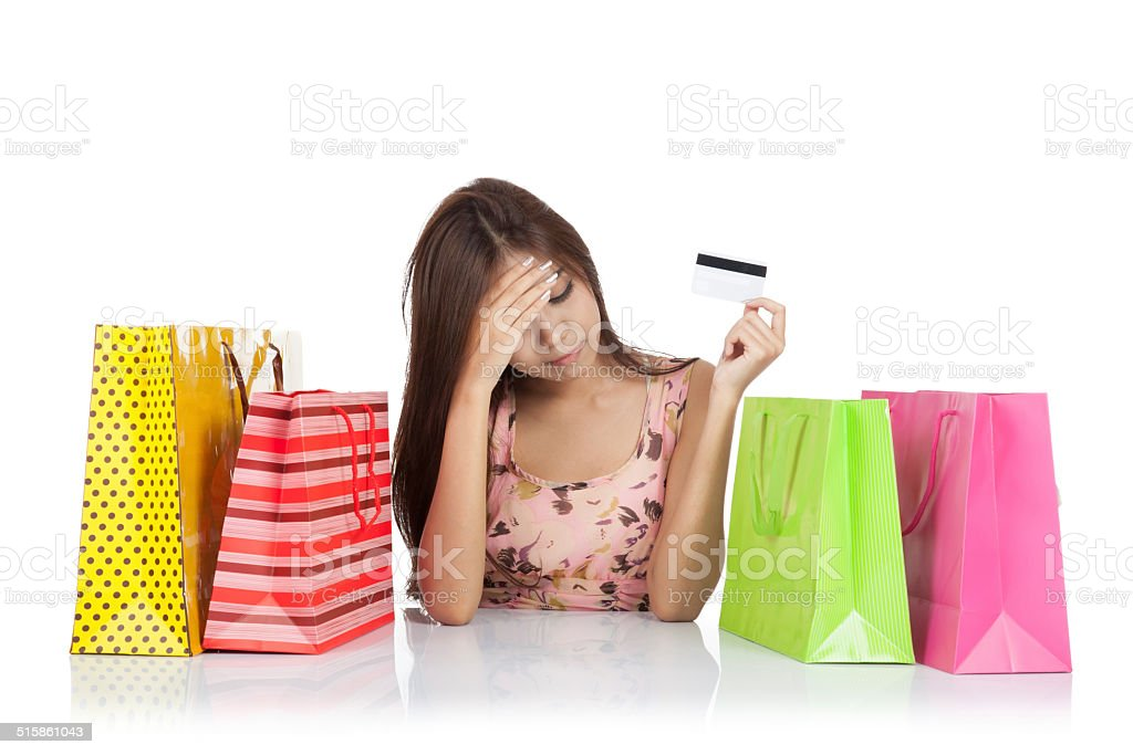 Asian woman fed up with credit card and shopping bag stock photo