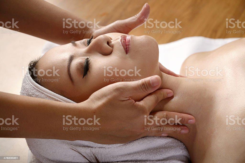 Asian Woman Get Facial Massage royalty-free stock photo