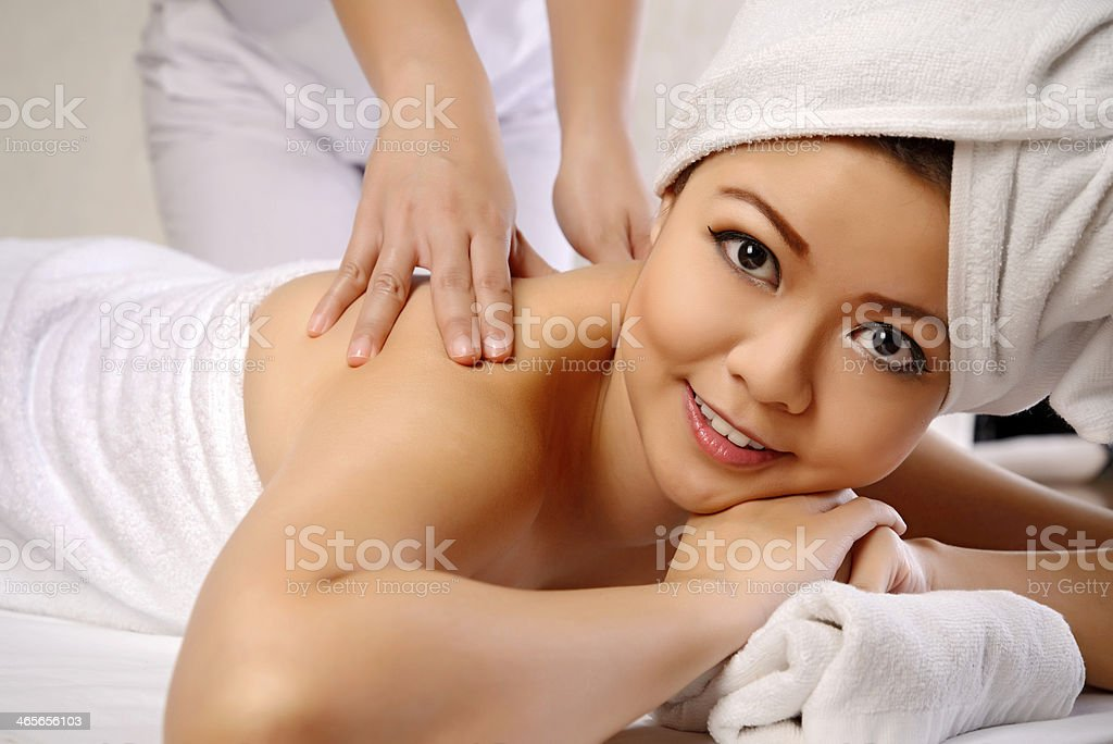 Asian Woman Get Massage On The Spa royalty-free stock photo