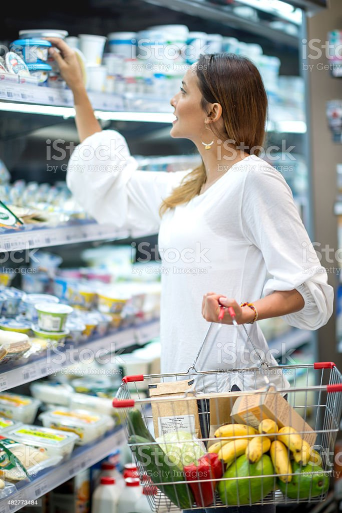 Asian woman grocery shopping at the supermarket stock photo