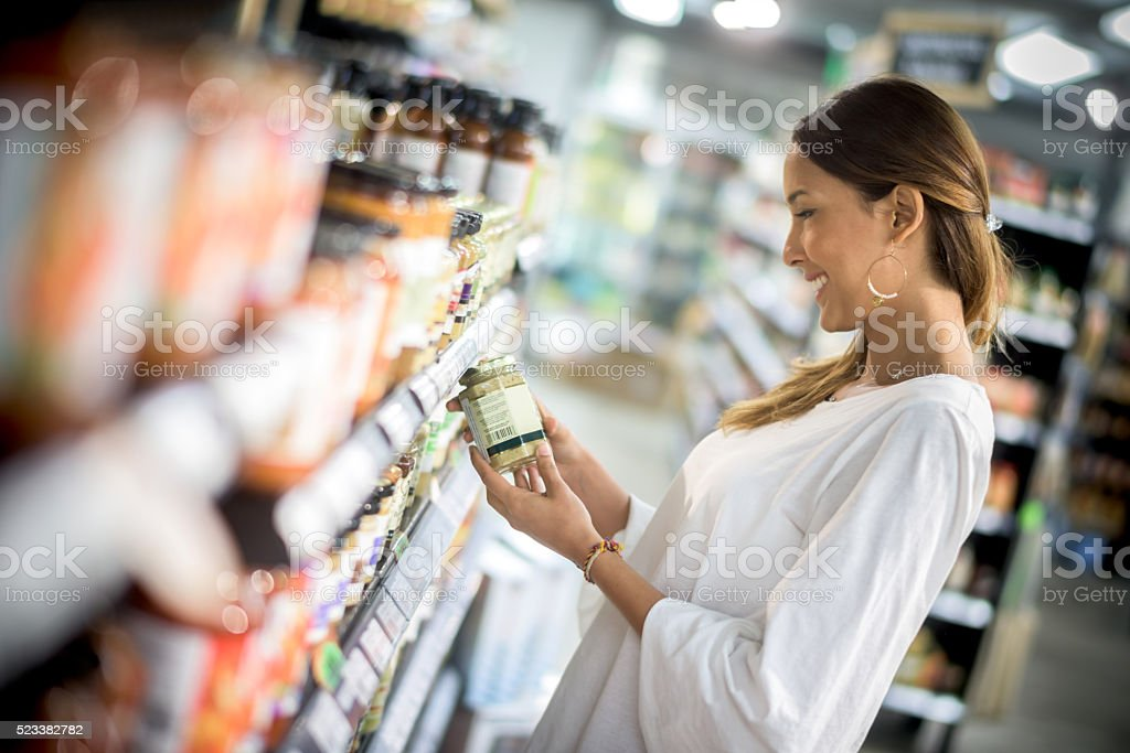 Asian woman grocery shopping stock photo