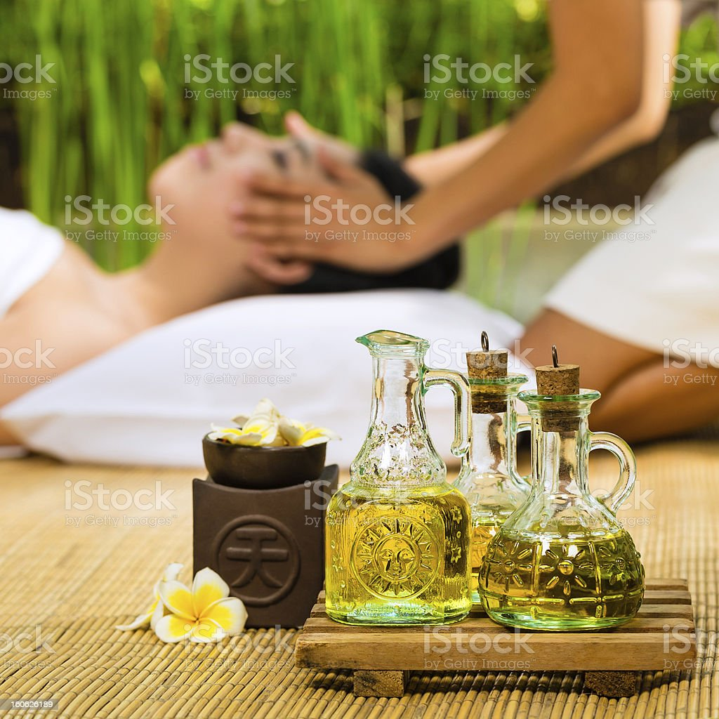Asian woman having a massage in tropical setting royalty-free stock photo