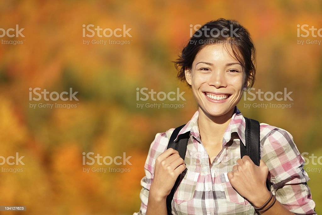 Asian woman hiker hiking in Autumn forest stock photo