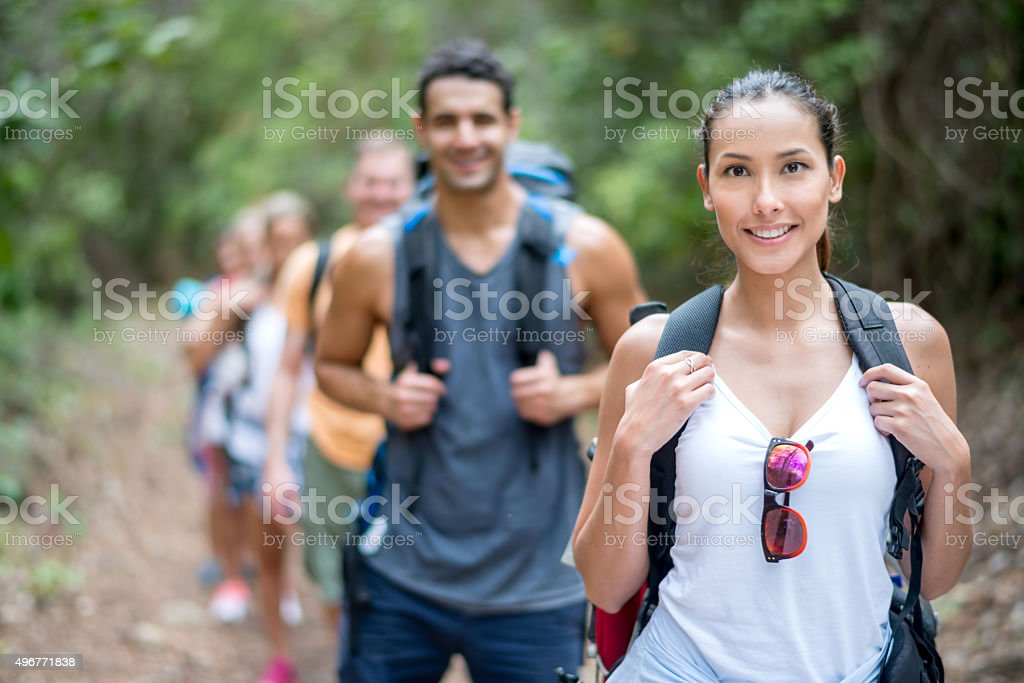 Asian woman hiking with some friends stock photo