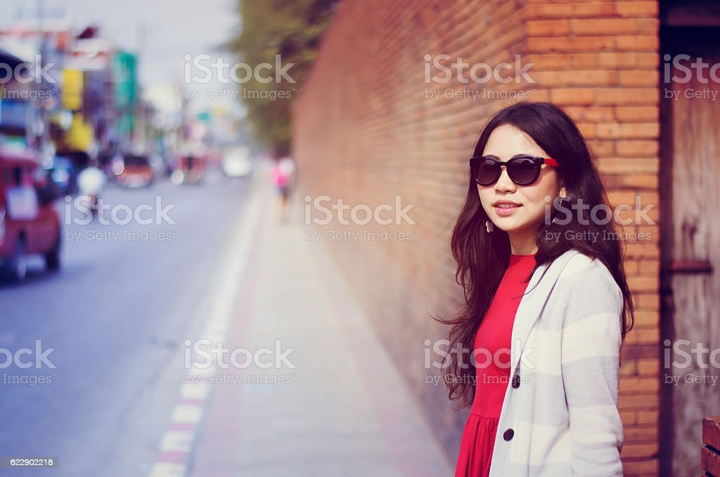 Asian woman hipster travel with fashion vintage sunset stock photo