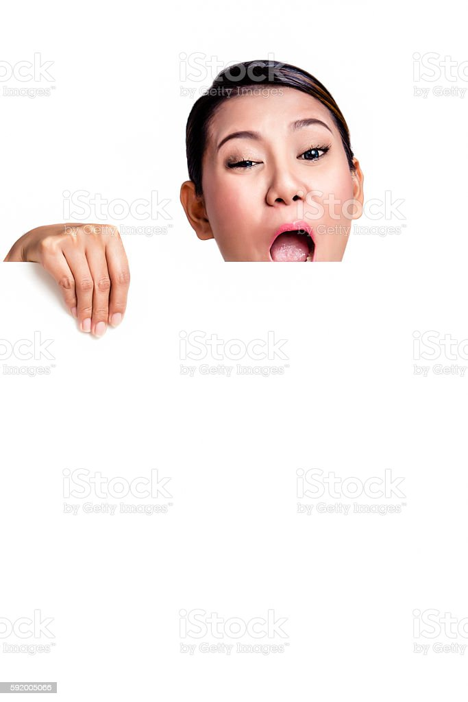 Asian woman holding a blank billboard. stock photo