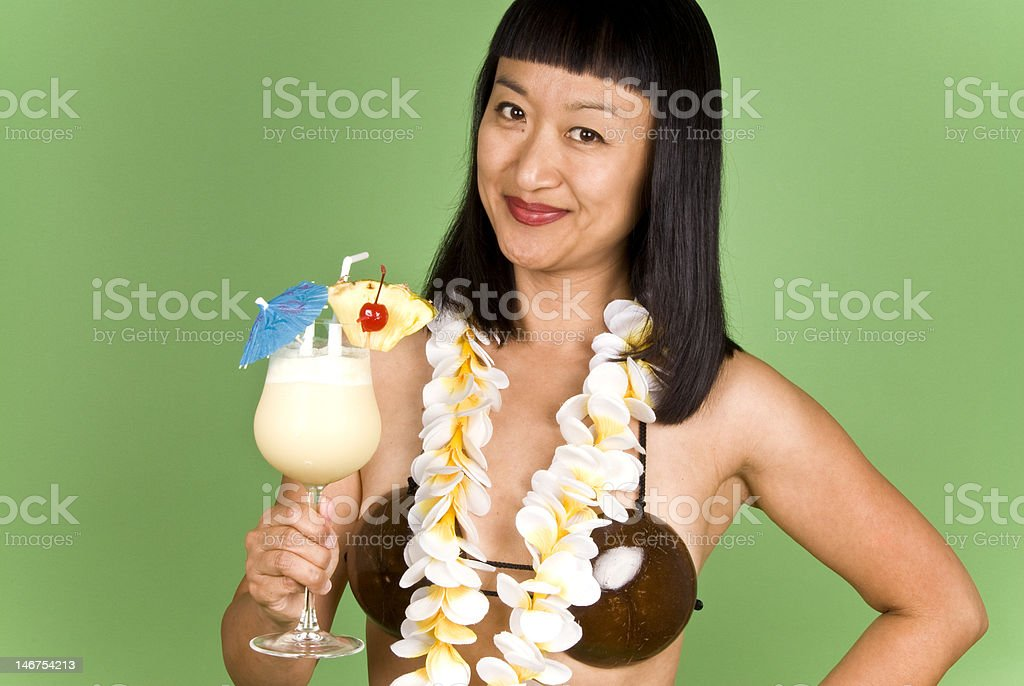 Asian Woman Holding a Glass of PIna Colada Cocktail royalty-free stock photo