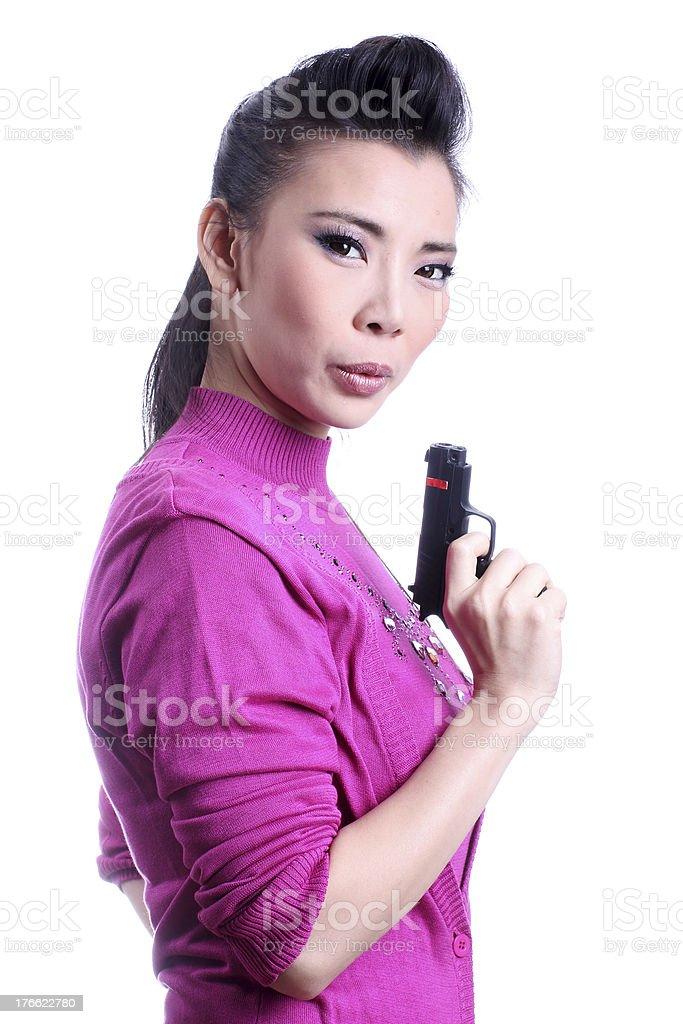 Asian woman holding a gun stock photo