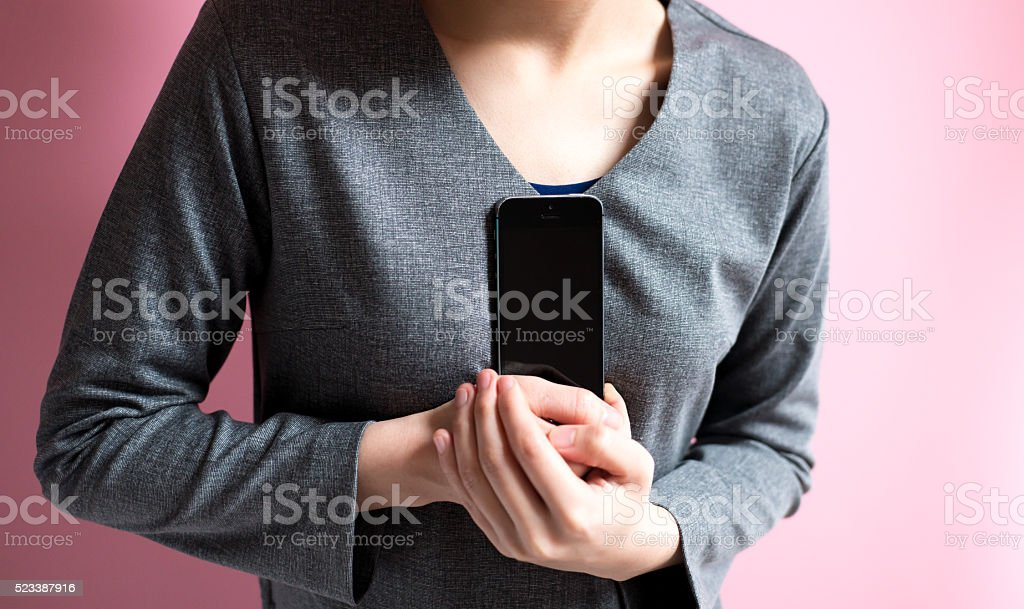 Asian woman holding a smartphone stock photo