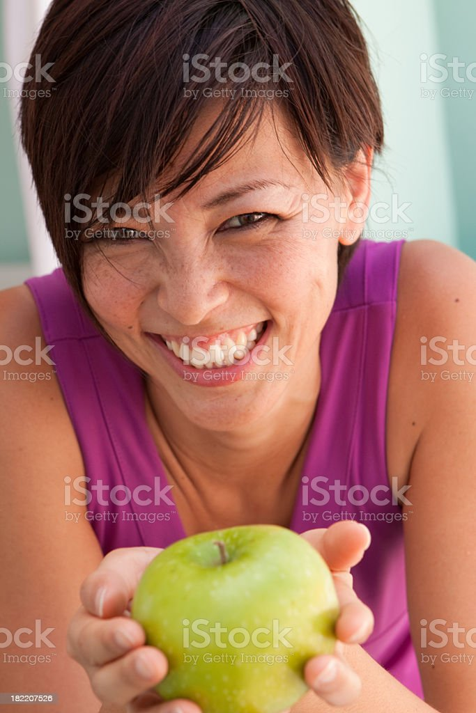 Asian Woman Holding Apple royalty-free stock photo