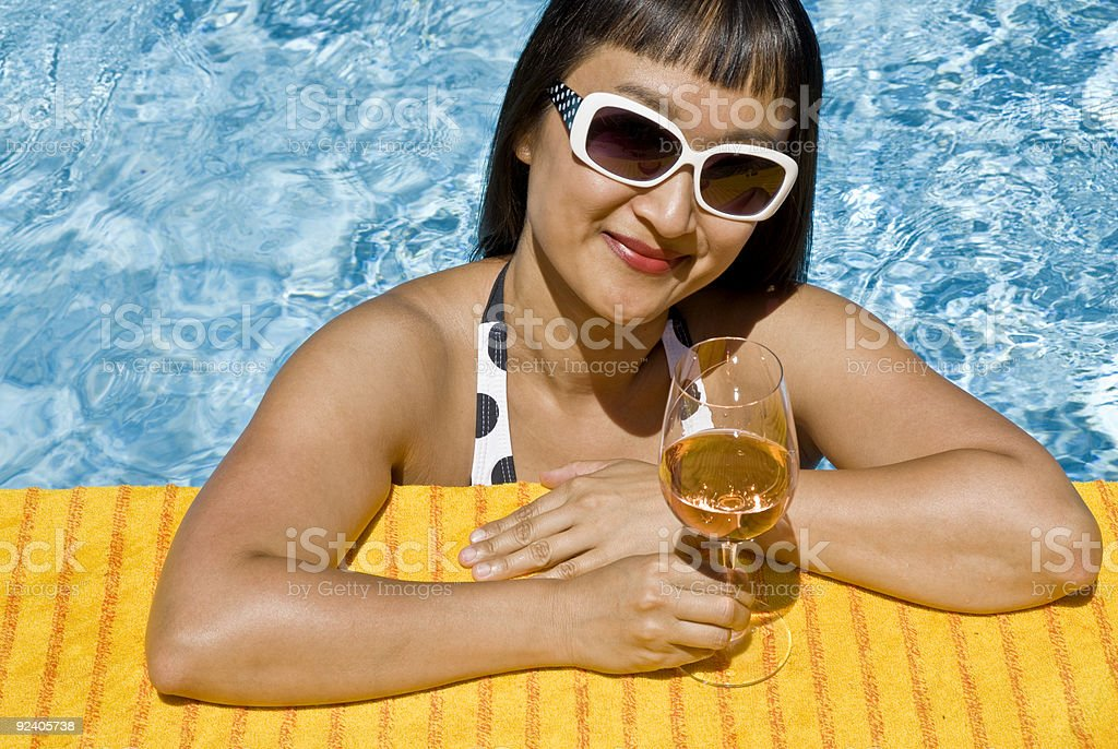 Asian Woman in a Swimming Pool royalty-free stock photo